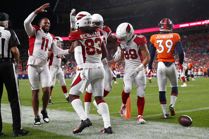 Arizona Cardinals wide receiver A.J. Richardson (83) celebrates his touchdown with wide receiver Larry Fitzgerald (11) during the second half of an NFL preseason football game against the Denver Broncos, Thursday, Aug. 29, 2019, in Denver. (AP Photo/David Zalubowski)