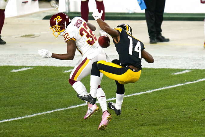 Washington Football Team cornerback Danny Johnson (32) breaks up a pass intended for Pittsburgh Steelers wide receiver Ray-Ray McCloud (14) during the first half of an NFL football game, Monday, Dec. 7, 2020, in Pittsburgh. (AP Photo/Keith Srakocic)