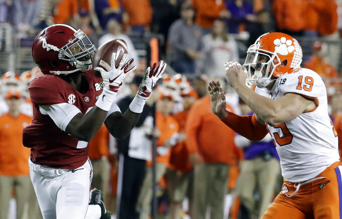 Alabama's Jerry Jeudy catches a touchdown pass in front of Clemson's Tanner Muse during the first half the NCAA college football playoff championship game, Monday, Jan. 7, 2019, in Santa Clara, Calif. (AP Photo/Chris Carlson)