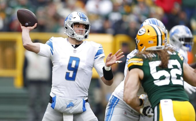 FILE - In this Sunday, Dec. 30, 2018 file photo, Detroit Lions' Matthew Stafford throws during the first half of an NFL football game against the Green Bay Packers in Green Bay, Wis. The NFL's six highest-paid quarterbacks in 2018 will be spectators this postseason. Green Bay's Aaron Rodgers ($33.5 million), Atlanta's Matt Ryan ($30 million), Minnesota's Kirk Cousins ($28 million), San Francisco's Jimmy Garoppolo ($27.5 million), Detroit's Matthew Stafford ($27 million) and Oakland's Derek Carr ($25 million) couldn't lead their teams to the playoffs. (AP Photo/Matt Ludtke, File)