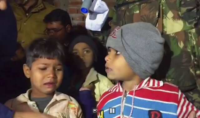 This Thursday, Jan. 30, 2020, frame grab from video provided by KK Productions shows children after they were rescued in Kasaria village in the northern Indian state of Uttar Pradesh. Authorities rescued 23 children after killing a man who held them hostage for nearly 11 hours after inviting them to his home for his daughter's birthday party in northern India, police said Friday. (KK Productions via AP)