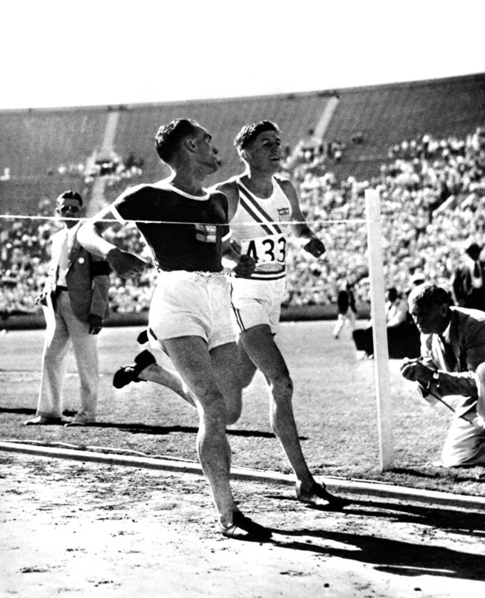 FILE - In this Aug. 5, 1932, file photo, Lauri Lehtinen, of Finland, left, beats Ralph Hill, of the United States, in the 5,000 meter final at the Olympic Stadium in Los Angeles. (AP Photo/File)