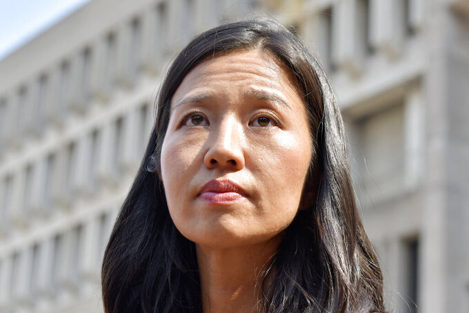 Mayoral Candidate City Councilor Michelle Wu looks on during a news conference outside City Hall in Boston, Wednesday, Sept. 15, 2021. Wu placed first in a preliminary mayoral runoff election that selected two top contenders from a field of five candidates all of whom are people of color, four of them women. (AP Photo/Josh Reynolds)