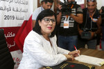 FILE - In this Aug. 2, 2019 file photo, President of the Free Destourian Party (PDL) Abir Moussi submits her candidacy for the upcoming presidential elections in Tunis, Tunisia. Since winning a parliamentary seat in 2019, Tunisian lawmaker Abir Moussi has become one of the country's most popular, and most controversial, politicians, riding a wave of nostalgia for a more stable and prosperous time, just as Tunisia marks 10 years since protesters overthrew autocratic former President Zine El Abidine Ben Ali. Since 2011, Tunisia has been plagued by sinking wages, growing joblessness and worsening public services. Unemployment has risen amid the coronavirus pandemic from 15% to 18%. Attempts to migrate to Europe by sea have soared. (AP Photo/File)
