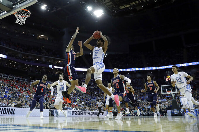 North Carolina's Coby White (2) heads to the basket during the first half of a men's NCAA tournament college basketball Midwest Regional semifinal game against Auburn Friday, March 29, 2019, in Kansas City, Mo. (AP Photo/Charlie Riedel)