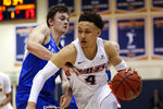 Pepperdine guard Colbey Ross, center, drives past BYU guard Connor Harding (44) during the first half of an NCAA college basketball game Saturday, Feb. 29, 2020, in Malibu, Calif. (AP Photo/Ringo H.W. Chiu)