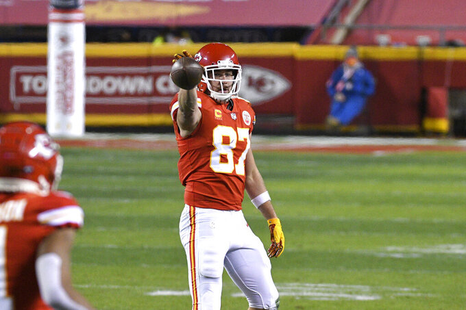 Kansas City Chiefs tight end Travis Kelce celebrates after catching a pass for a first down during the first half of the AFC championship NFL football game against the Buffalo Bills, Sunday, Jan. 24, 2021, in Kansas City, Mo. (AP Photo/Reed Hoffmann)