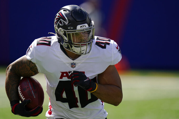 Atlanta Falcons fullback Keith Smith runs the ball during the first half of an NFL football game against the New York Giants, Sunday, Sept. 26, 2021, in East Rutherford, N.J. (AP Photo/Seth Wenig)