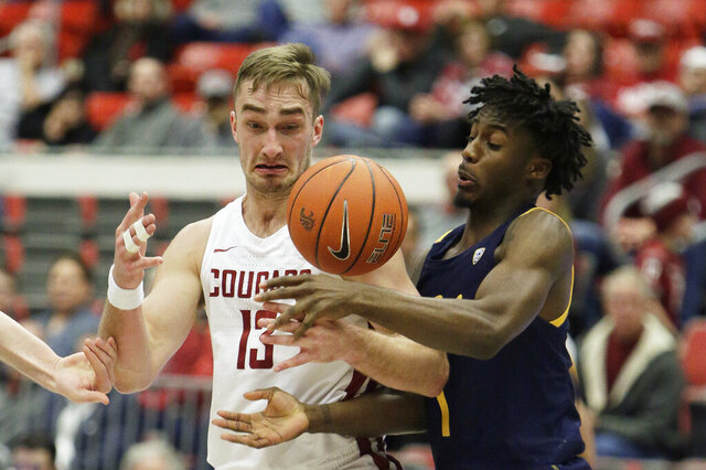 Washington State forward Jeff Pollard, left, and California guard Joel Brown go after the ball during the second half of an NCAA college basketball game in Pullman, Wash., Wednesday, Feb. 19, 2020. California won 66-57. (AP Photo/Young Kwak)