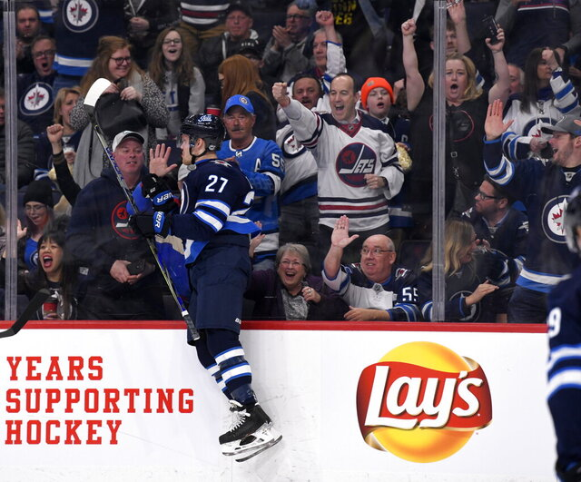 Winnipeg Jets' Nikolaj Ehlers (27) celebrates his goal against the Arizona Coyotes during second-period NHL hockey game action in Winnipeg, Manitoba, Monday, March 9, 2020. (Fred Greenslade/The Canadian Press via AP)