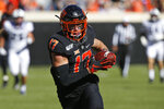 Oklahoma State wide receiver Dillon Stoner (17) runs into the end zone with a touchdown in the first half of an NCAA college football game against TCU in Stillwater, Okla., Saturday, Nov. 2, 2019. (AP Photo/Sue Ogrocki)