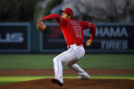 CORRECTS POSITION TO STARTING PITCHER INSTEAD OF DESIGNATED HITTER - Los Angeles Angels starting pitcher Shohei Ohtani throws to the plate during the first inning of a baseball game against the Tampa Bay Rays, Wednesday, May 5, 2021, in Anaheim, Calif. (AP Photo/Mark J. Terrill)