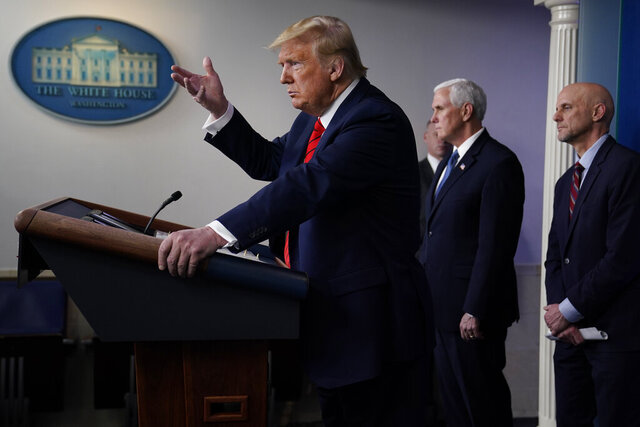 President Donald Trump speaks during press briefing with the coronavirus task force, at the White House, Thursday, March 19, 2020, in Washington. Food and Drug Administration Commissioner Dr. Stephen Hahn, right,and Vice President Mike Pence listen. (AP Photo/Evan Vucci)