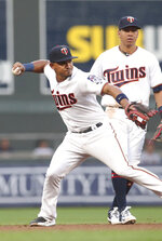 Minnesota Twins third baseman Eduardo Escobar throws out of St. Louis Cardinals' Jedd Gyorko after fielding his grounder during the fourth inning of a baseball game Tuesday, May 15, 2018, in Minneapolis. (AP Photo/Jim Mone)