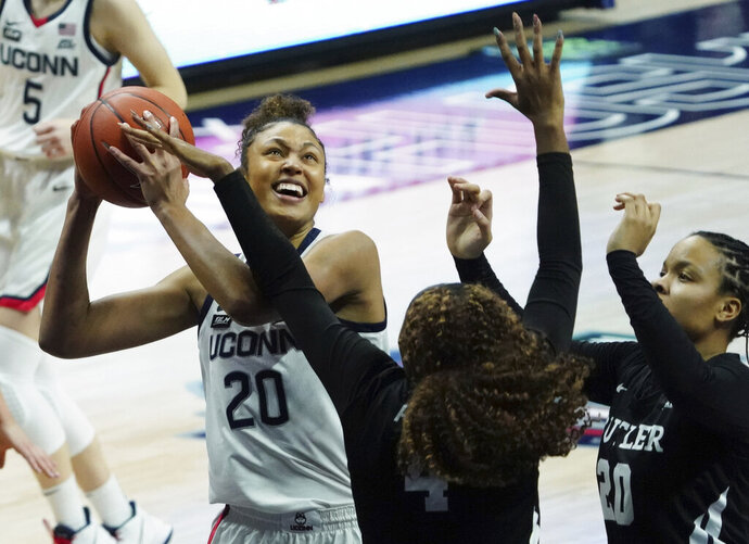 UConn forward Olivia Nelson-Ododa (20) shoots against Butler in the first half of an NCAA college basketball game Tuesday, Jan. 19, 2021, in Storrs, Conn. (David Butler II/Pool Photo via AP)