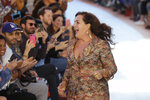 FILE - In this Sept. 23, 2017 file photo designer Angela Missoni acknowledges applauses at the end of the Missoni women's Spring/Summer 2018/19 fashion collection, presented in Milan. Angela Missoni is leaving the role of creative director after 24 years at the fashion house founded by her parents, Ottavio and Rosita Missoni. (AP Photo/Luca Bruno)