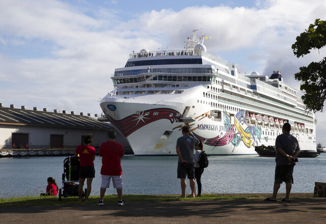 The Norwegian Jewel cruise ship docks at Honolulu Harbor on Sunday, March 22, 2020. The cruise ship that had to cut short its trip because of the new coronavirus and mechanical problems docked Sunday in Honolulu's harbor. (Cindy Ellen Russell/Honolulu Star-Advertiser via AP)