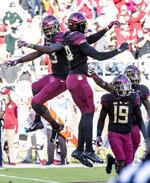 Florida State defensive back Hamsah Nasirildeen, left, and defensive end Brian Burns celebrate Nasirildeen's interception of a Boston College pass in the first quarter of an NCAA college football game in Tallahassee, Fla., Saturday, Nov. 17, 2018. (AP Photo/Mark Wallheiser)