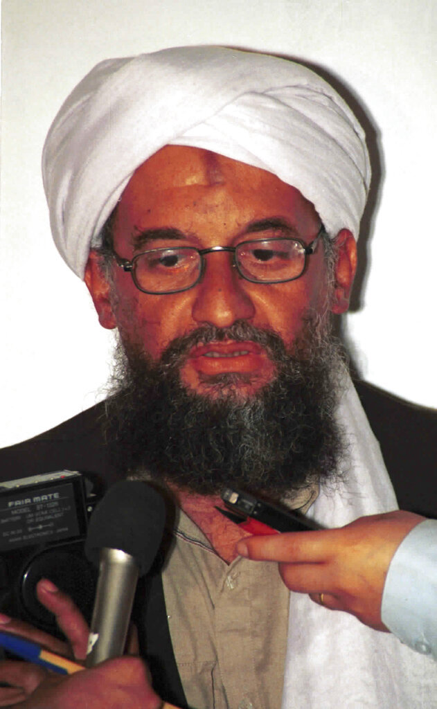 FILE - In this in this 1998 file photo made available Friday, March 19, 2004, Ayman al-Zawahri speaks to the press in Khost, Afghanistan. On Wednesday, Sept, 11, 2019, Al-Qaeda leader al-Zawahri called on all Muslims to attack U.S., European, Israeli and Russian targets in a speech on the 18th anniversary of the 9/11 terror attacks. SITE Intelligence Group reports that in a video released by the militant group, al-Zawahri  also criticized