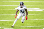 Tennessee Titans safety Kevin Byard (31) is shown in action in the third quarter during an NFL football game against the Minnesota Vikings, Sunday, Sept. 27, 2020, in Minneapolis. The NFL's ranks of undefeated teams should thin by one Tuesday night, Oct. 13, 2020, when the Buffalo Bills and Tennessee Titans finally meet in a rescheduled game. (AP Photo/David Berding, File)