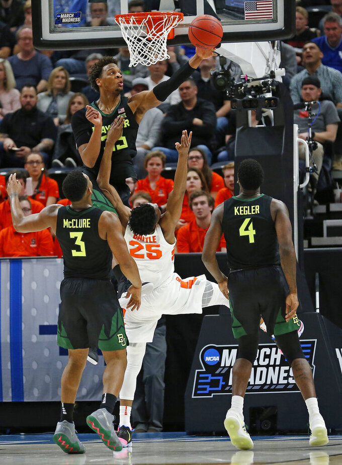 Baylor's Freddie Gillespie, top, blocks the shot of Syracuse guard Tyus Battle (25) as Baylor's King McClure (3) and Mario Kegler (4) watch the second half of a first-round game in the NCAA men's college basketball tournament Thursday, March 21, 2019, in Salt Lake City. (AP Photo/Rick Bowmer)