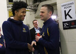 Murray State's head coach Matt McMahon, right, greets Ja Morant after a news conference at the men's college basketball NCAA Tournament, Friday, March 22, 2019, in Hartford, Conn. Murray State will play Florida State on Saturday. (AP Photo/Elise Amendola)