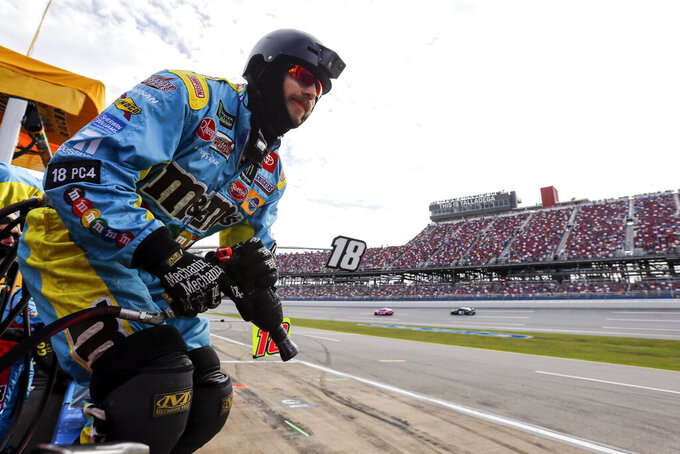 A crew member for Kyle Busch waits to jump over the wall during a NASCAR Cup Series auto race at Talladega Superspeedway, Monday, Oct 14, 2019, in Talladega, Ala. (AP Photo/Butch Dill)