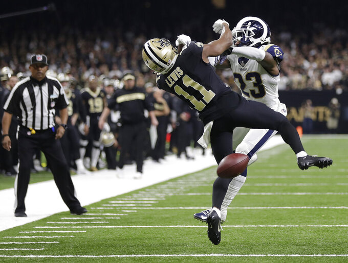 FILE-In this Sunday, Jan. 20, 2019 file photo, New Orleans Saints wide receiver Tommylee Lewis (11) works for a catch against Los Angeles Rams defensive back Nickell Robey-Coleman (23) during the second half the NFL football NFC championship game, in New Orleans. The NFL's video review system for pass interference calls could be scrapped after one season. An offseason survey by the powerful competition committee, which recommends rules adjustments, shows strong opposition to the system installed last year. (AP Photo/Gerald Herbert, File)