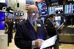 Trader John Doyle works on the floor of the New York Stock Exchange, Thursday, Feb. 6, 2020. U.S. stocks rose in midday trading Thursday as investors continued focusing on the latest round of corporate earnings and China cut tariffs on key imports as part of a trade war truce. (AP Photo/Richard Drew)