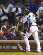 Chicago Cubs' Willson Contreras watches his grand slam during the first inning of the team's baseball game against the Chicago White Sox on Wednesday, June 19, 2019, at Wrigley Field in Chicago. (AP Photo/Paul Beaty)