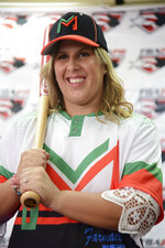 First baseman and member of the National Women's Baseball Team, Diamilette Quiles Alicea, is presented as the first female player to sign with The Utuado Highlanders, one of the teams that participate in the Superior Double A Baseball League, in San Juan, Puerto Rico, Thursday, May 16, 2019. For the first time in Puerto Rico's history, a woman is set to play in an otherwise all-male baseball tournament organized by a popular semi-pro league.(AP Photo/Carlos Giusti)