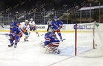 New York Islanders' Josh Bailey (12) watches a second-period goal by teammate Anthony Beauvillier (not shown) against New York Rangers' Igor Shesterkin (31) during an NHL hockey game Thursday, April 29, 2021, in New York. (Bruce Bennett/Pool Photo via AP)