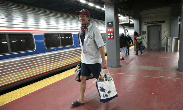 Timothy Mahyna arrives on a train from Georgia at Amtrak's Penn Station, Thursday, Aug. 6, 2020, in New York. Mayor de Blasio is asking travelers from 34 states, including Georgia where COVID-19 infection rates are high, to quarantine for 14 days after arriving in the city. Mahyna, from Syracuse, N.Y., said,