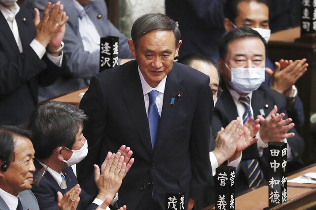 Yoshihide Suga is applauded after being elected as Japan's new prime minister at parliament's lower house in Tokyo, Wednesday, Sept. 16, 2020. Suga was formally elected Wednesday as Japan's new prime minister in a parliamentary vote, replacing Shinzo Abe. (AP Photo/Koji Sasahara)