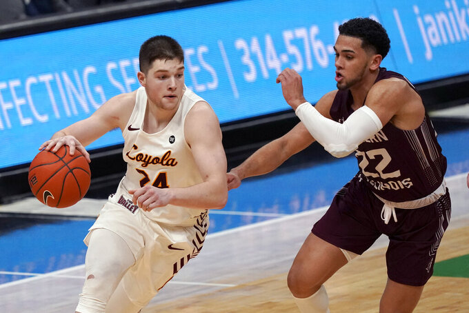 Loyola of Chicago's Tate Hall (24) heads to the basket as Southern Illinois' Steven Verplancken Jr. (22) defends during the second half of an NCAA college basketball game in the quarterfinal round of the Missouri Valley Conference men's tournament Friday, March 5, 2021, in St. Louis. (AP Photo/Jeff Roberson)