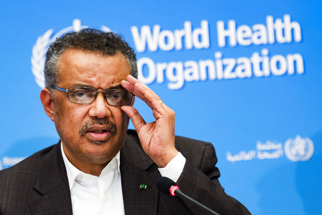FILE- In this Jan. 30, 2020, file photo, Tedros Adhanom Ghebreyesus, Director General of the World Health Organization (WHO), talks to the media at the World Health Organization headquarters in Geneva, Switzerland. China said Monday, Jan. 11, 2021, that a group of experts from the World Health Organization are due to arrive this week for an investigation into the origins of the coronavirus pandemic. (Jean-Christophe Bott/Keystone via AP, File)