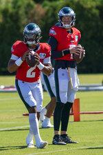 Philadelphia Eagles quarterback Jalen Hurts, left, runs a drill with quarterback Nate Sudfeld, right, during an NFL football practice, Thursday, Aug. 20, 2020, in Philadelphia. (AP Photo/Chris Szagola, Pool)