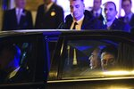 Libyan Gen. Khalifa Hifter, back left, arrives at a hotel in Athens, Thursday, Jan. 16, 2019. Greece will block any European peace deal on Libya unless an agreement between the internationally-recognized government in Tripoli and Turkey on maritime borders is scrapped, Greek Prime Minister Kyriakos Mitsotakis warned Thursday. (AP Photo/Michael Varaklas)