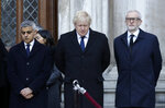 Britain's Prime Minister Boris Johnson, center, Labour Party leader Jeremy Corbyn, right, and Mayor of London Sadiq Khan take part in a vigil at Guildhall Yard in London, Monday Dec. 2, 2019, to remember the London attack victims and honor members of the emergency services and bystanders who fought the attacker. London Bridge reopened to cars and pedestrians Monday, three days after a man previously convicted of terrorism offenses stabbed two people to death and injured three others before being shot dead by police. (AP Photo/Matt Dunham)