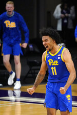 Pittsburgh guard/forward Justin Champagnie (11) reacts after scoring a basket against Northwestern during the second half of an NCAA college basketball game in Evanston, Ill., Wednesday, Dec. 9, 2020. Pittsburgh won 71-70. (AP Photo/Nam Y. Huh)