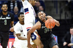 Tulane's Nic Thomas (14) tries to get around Connecticut's Tyler Polley (12) in the first half of an NCAA college basketball game Wednesday, Jan. 8, 2020, in Storrs, Conn. (AP Photo/Stephen Dunn)