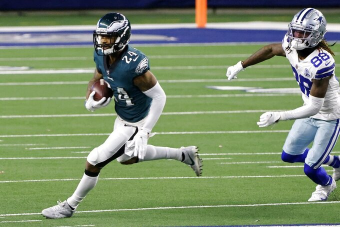Philadelphia Eagles cornerback Darius Slay (24) intercepts a pass intended for Dallas Cowboys wide receiver CeeDee Lamb (88) in the second half of an NFL football game in Arlington, Texas, Sunday, Dec. 27. 2020. (AP Photo/Michael Ainsworth)