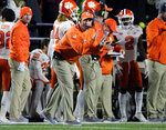 Clemson coach Dabo Swinney shouts encouragement from the sideline in the first half of the team's NCAA college football game against Boston College, Saturday, Nov. 10, 2018, in Boston. (AP Photo/Elise Amendola)