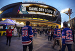 FILE - In this Jan. 7, 2018, file photo, New York Rangers fans arrive at T-Mobile Arena for an NHL hockey game between the Rangers and the Vegas Golden Knights in Las Vegas. T-Mobile Arena is one of the possible locations the NHL has zeroed in on to host playoff games if it can return amid the coronavirus pandemic. The league will ultimately decide on two or three locations for games, with government regulations, testing and COVID-19 frequency among the factors for the decision that should be coming within the next three to four weeks. (AP Photo/L.E. Baskow, File)