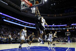 Butler's Kamar Baldwin (3) goes up for a shot past Villanova's Collin Gillespie (2) during the second half of an NCAA college basketball game, Saturday, March 2, 2019, in Philadelphia. Villanova won 75-54. (AP Photo/Matt Slocum)