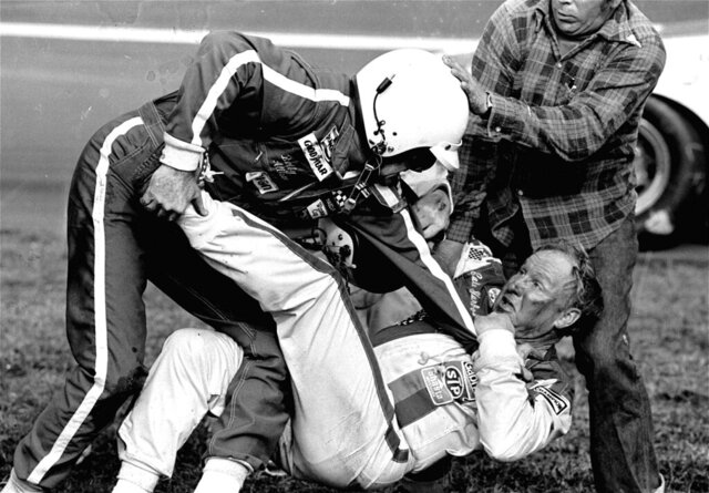 FILE - In this Feb. 18, 1979, file photo, Bobby Allison, left, grabs Cale Yarborough after a collision between Yarborough and Allison's brother Donnie on the last lap of the Daytona 500 auto race in Daytona Beach, Fla. (AP Photo/Ric Feld, File)