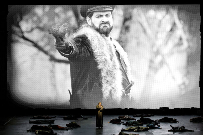 This undated photo made available by La Scala opera theater on Dec. 5, 2018 shows Spanish soprano Saioa Hernandez performing on stage in front of a screen showing Russian bass Ildar Abdrazakov during a rehearsal of Giuseppe Verdi's