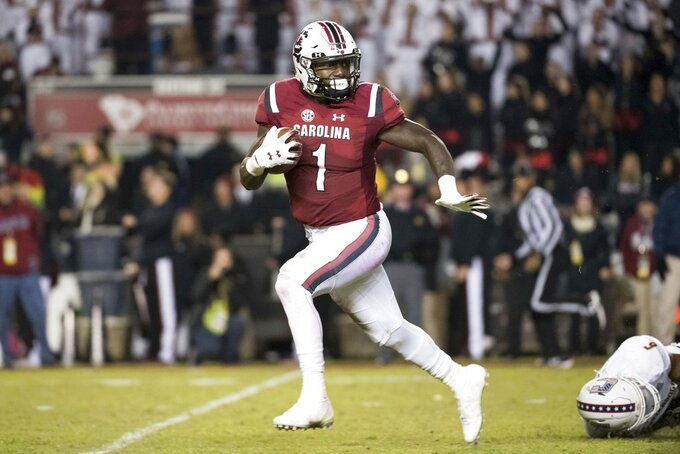 South Carolina wide receiver Deebo Samuel (1) breaks away for a touchdown during the second half of an NCAA college football game against Chattanooga Saturday, Nov. 17, 2018, in Columbia, S.C. (AP Photo/Sean Rayford)