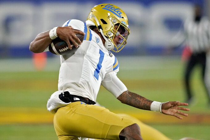 UCLA quarterback Dorian Thompson-Robinson carries the ball against Arizona State during the first half of an NCAA college football game Saturday, Dec. 5, 2020, in Tempe, Ariz. (AP Photo/Matt York)