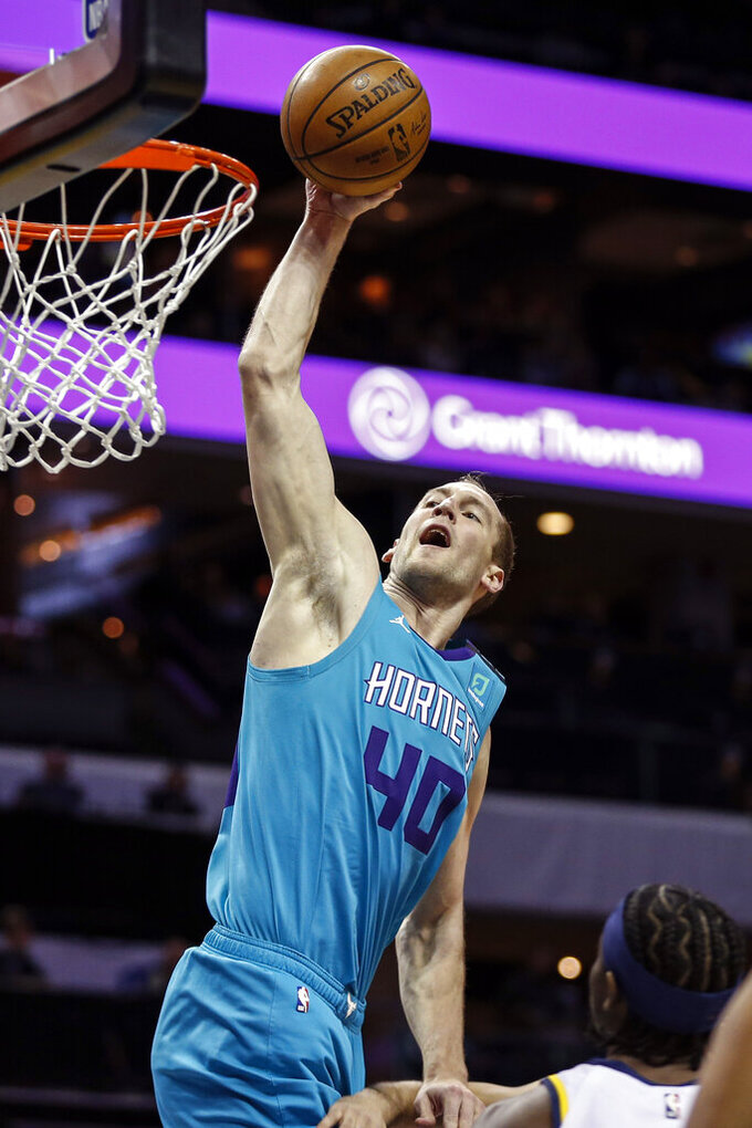 Charlotte Hornets forward Cody Zeller dunks against the Indiana Pacers in the first half of an NBA basketball game in Charlotte, N.C., Monday, Jan. 6, 2020. (AP Photo/Nell Redmond)